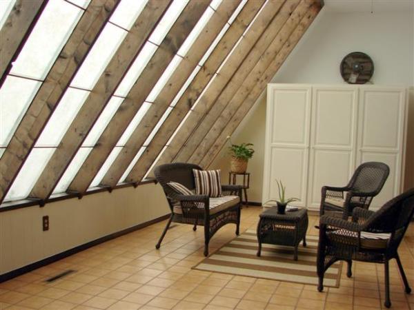 sunroom provides passive solar heat in this ranch